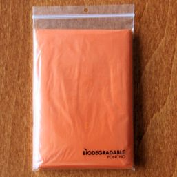 Biodegradable poncho transparent orange 9689